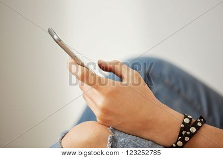 Closeup Image Of A Teenager Is Searching Information In Network On Mobile Phone During Free Time. Yo