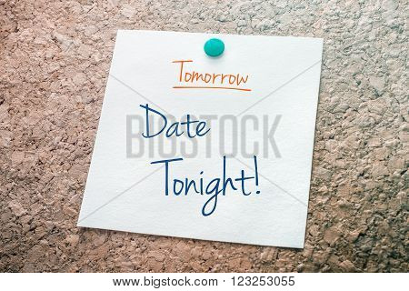 Date Tonight Reminder For Tomorrow On Paper Pinned On Cork Board