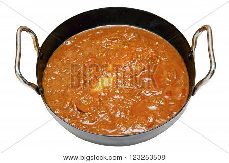 Balti butter chicken in a karahi bowl with an isolated white background and clipping path