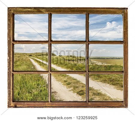 prairie road as seen  through vintage, grunge, sash window with dirty glass