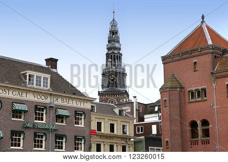 AMSTERDAM; THE NETHERLANDS - AUGUST 16; 2015: View of Oude Kerk (Old Church) from Damrak canal. Amsterdam is capital of the Netherlands on August 16; 2015.