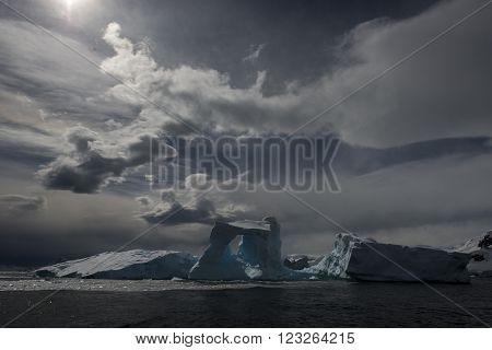 Iceberg off coast of Antarctica travel on Zodiak in sunset
