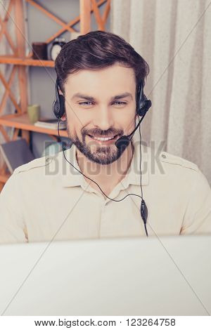 Close Up Portrait Of Cheerful Young Worker In Head-phones Talking With Clients
