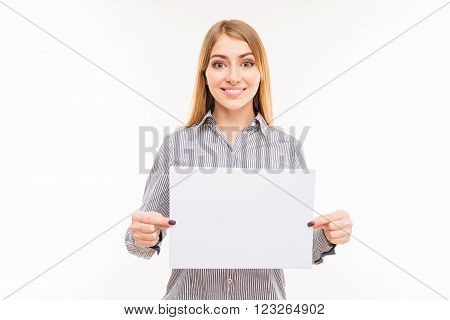 Young positive businesswoman showing blank sheet of paper