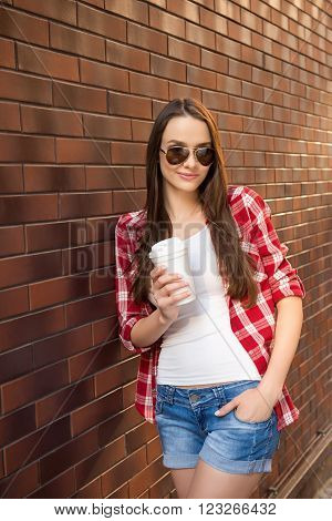 Pretty Smiling Girl In Spetacles Holding Up Of Coffee