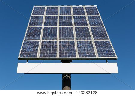 Blue sky and solar panel with hoarding and free copy space for text