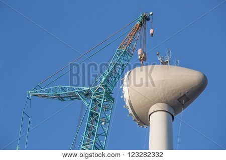 Construction site new wind turbine with hoisting of rotor house