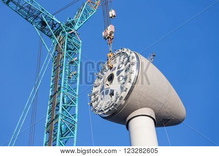 Installing rotor house at the top of a big new Dutch wind turbine