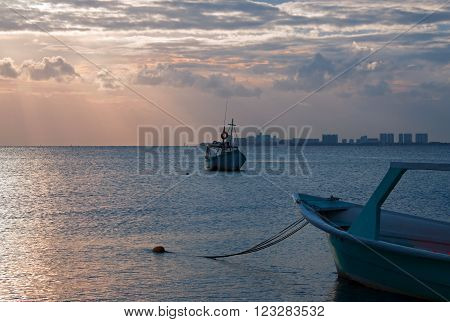 Sunrise View of anchored Fishing Boats in Cancun Mexico's Puerto Juarez Harbor