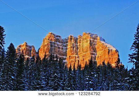 Breccia Cliffs glowing at alpenglow sunset on Togwotee Pass between Jackson Hole and Dubois Wyoming USA