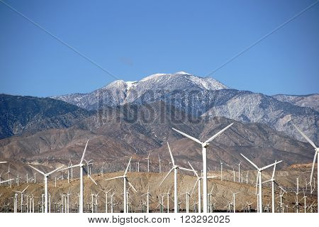 A wind turbine park in front of the the San Jacinto Peak or Mount San Jacinto near Palm Springs. ** Note: Soft Focus at 100%, best at smaller sizes