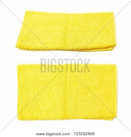 Single yellow terry cloth towel isolated over the white background, set collection of two different foreshortenings