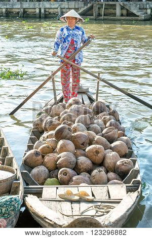Soc Trang, Vietnam - February 2nd, 2016: Farmers are selling boating dock on the river dried coconut countryside in the afternoon at the floating market Soc Trang, Vietnam