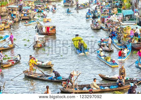 Soc Trang, Vietnam - February 3rd, 2016: Boat carrying daisies trade on the river at the end of the year around is the busiest boats agricultural trade makes the scene more beautiful countryside in Soc Trang, Vietnam