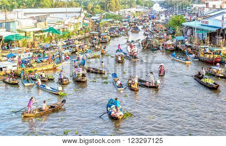 Soc Trang, Vietnam - February 3rd, 2016: Bustling some boats reverse sweep on the morning floating market with hundreds boatload of flowers, agricultural products and vegetables as festival trafficking in Soc Trang, Vietnam