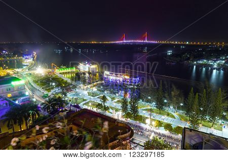 Can Tho, Vietnam - February 3rd, 2016: night city Can Tho Ninh Kieu wharf river with many sparkling lights, so far as Can Tho Bridge shines at night makes more lively night scene in Can Tho, Vietnam