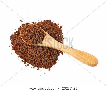 Heart shape made of instant coffee grains with the wooden spoon over it, composition isolated over the white background