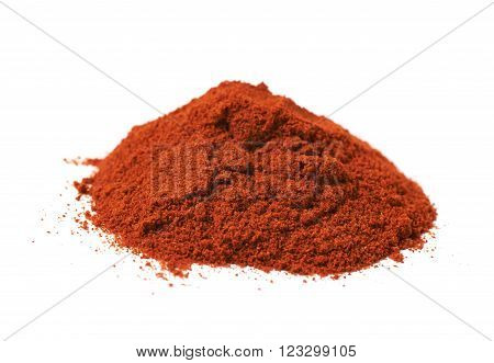 Pile of red paprika powder isolated over the white background