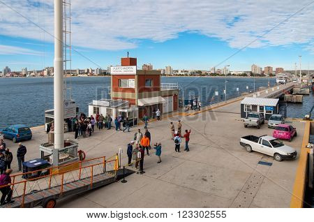 Puerto Madryn, Argentina - December 13, 2012: People on the pier at Puerto Madryn, Patagonia, Argentina.