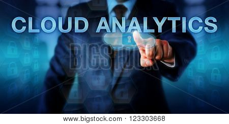 Information technology leader is touching CLOUD ANALYTICS on a virtual interface. Information technology concept and business strategy metaphor for efficient cloud computing resource utilization.