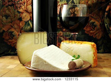 three cheeses with a bottle and glass of red wine poster