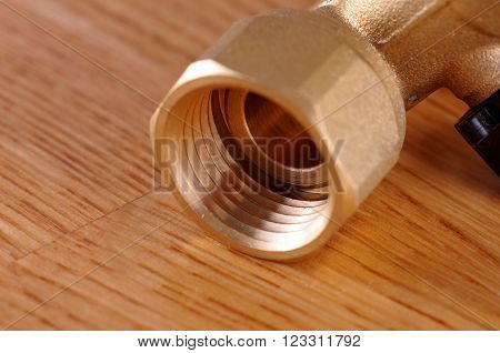 Tap on wooden background. Tap from Reverse Osmosis water filter system.