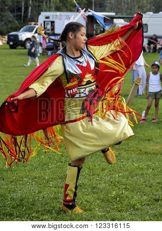 Caribou, Maine/USA August 23 2015: Native American woman from the Micmac tribe dances at a Pow Wow in the Northern Maine town of Caribou on August 23, 2015. She wore traditional dress.