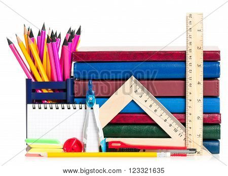 School accessories with books isolated on white background