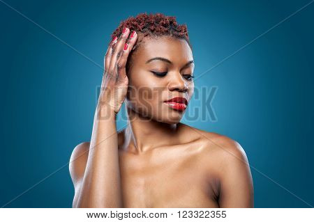 Black beautiful woman with short spiky red hair