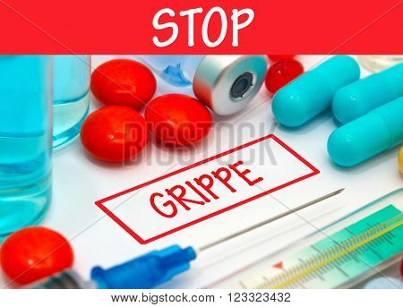 Stop grippe. Vaccine to treat disease. Syringe and vaccine with drugs.