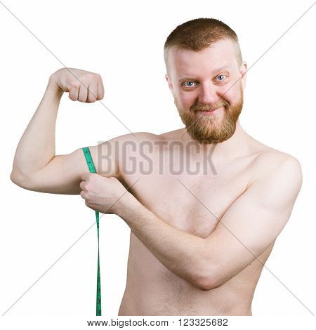 Funny bearded man measures his little biceps