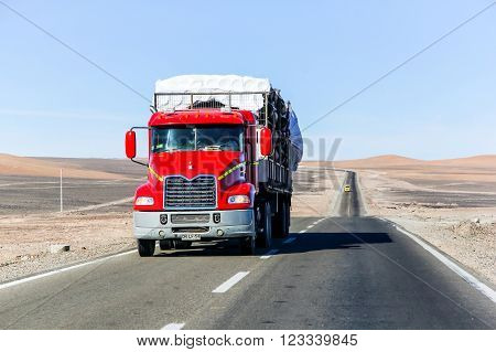 ATACAMA, CHILE - NOVEMBER 14, 2015: Red semi-trailer truck Mack Vision at the interurban freeway throught the Atacama Desert (Ruta del Desierto).