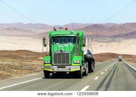 ATACAMA, CHILE - NOVEMBER 18, 2015: Green semi-trailer truck Kenworth T800 at the interurban freeway throught the Atacama Desert (Ruta del Desierto).