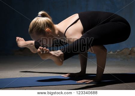 Beautiful Yoga Woman Standing In Firefly Posture