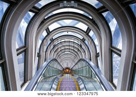 Osaka, Japan - April 29, 2014: View of the spectacular escalator in Umeda Sky Building, a modern high rise skyscraper in the Kita district of Osaka, near Umeda Stations.