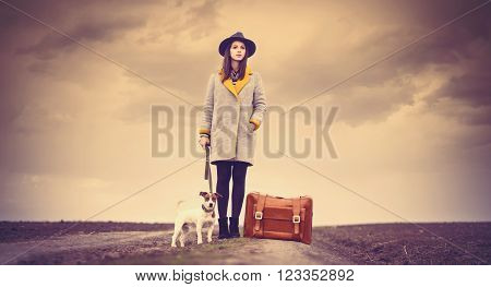 Portrait Of Young Woman With Suitcase And Dog