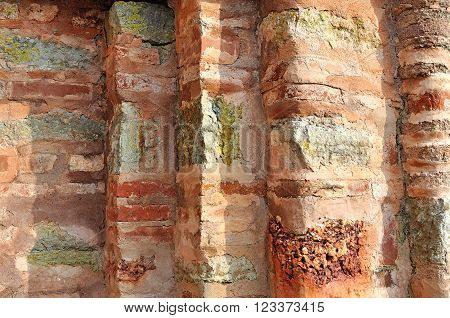 Architectural background - aged textured wall made of thin calcined brick known as plinfa. Plinfa used in construction of Byzantium and Ancient Rus