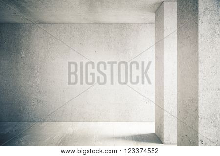 Sunlit interior with blank concrete wall and floor. Mock up