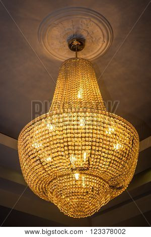 Old vintage chandelier with gold crystal lights