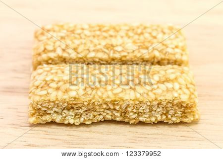 Close- up Chinese sweetmeat or Asian Chinese candy is a traditional Chinese food. Sesame brittle