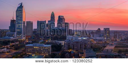 The amazing and colorful sky in Uptown Charlotte, North Carolina right before sunrise on a beautiful spring morning.