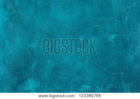 Old scratched and chapped painted blue wall. Abstract textured turquoise background, empty template