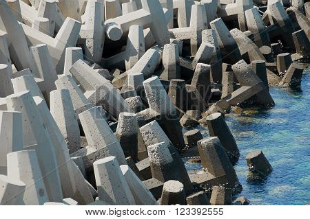 Concrete tetrapods used for protection against erosion slong the shoreline