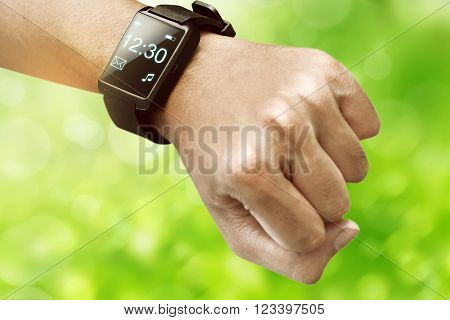 Human hand wearing smart watch. Wearable gadget concept