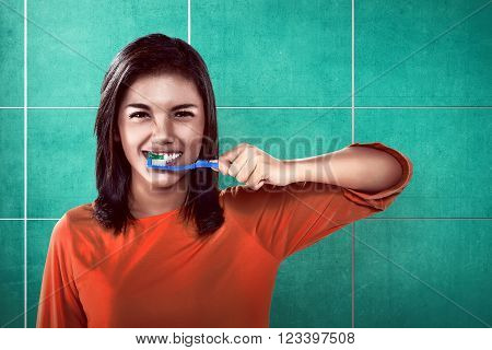 Asian woman brushing her teeth on the bathroom