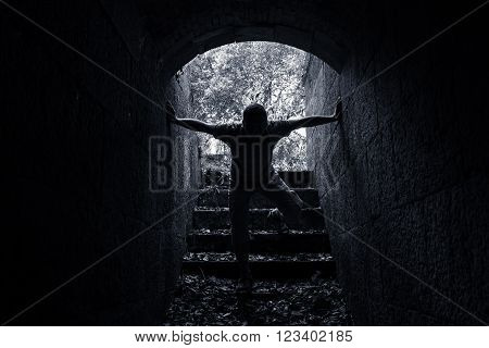 Young Scary Man Enters Dark Stone Tunnel
