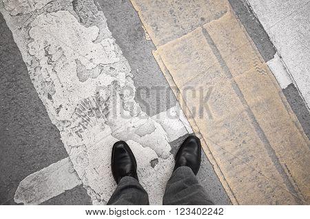 Urbanite Man Stands On  Pedestrian Crossing