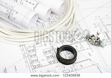 Architecture plan and rolls of blueprints with cabel and adhesive tape. Building concept