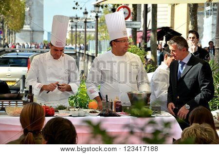 PARIS / FRANCE - September 23 2011: Street cooking presentation of the FRERES BLANC company in the Avenue des Champs-Elysees