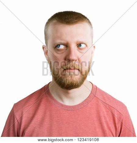 Bearded man looking eyes away from himself